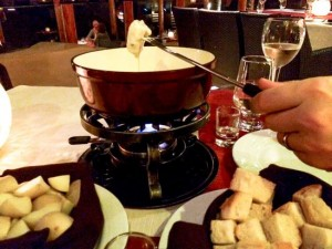 A candle keeps classic fondue at the perfect consistency.